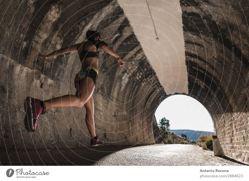Runner and tunnel Lifestyle Sports Human being Woman Adults 18 - 30 years Youth (Young adults) Nature Brunette Running Jump young people healthy fit