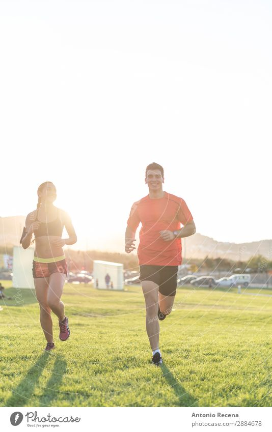 Runner couple Lifestyle Happy Summer Sports Human being Woman Adults Man Couple 2 Nature Park Brunette Fitness Running Muscular young people healthy fit athlete