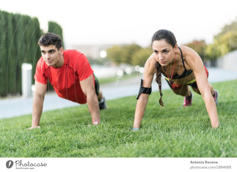 City training Sports Sportsperson Human being Woman Adults Man Couple 2 18 - 30 years Youth (Young adults) Brunette Fitness Strong Effort push ups Runner