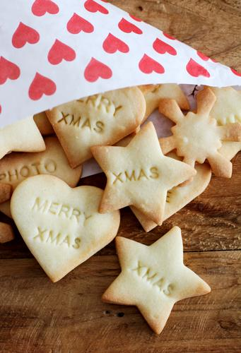 Christmas & Advent Love Eating Food Heart Characters Nutrition Sweet Cooking & Baking Symbols and metaphors Delicious Candy Dessert Cookie Wooden table Baker