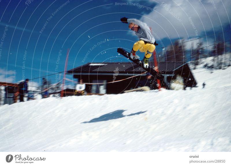 self-made air Jump Winter Snowboard Vacation & Travel Winter vacation Sports raceboard Joy Ski run Alpine hut Motion blur Yellow Bent 1 Shadow Snowboarder