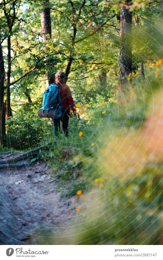 Woman hiker with backpack walking in forest during summer trip Lifestyle Beautiful Relaxation Leisure and hobbies Vacation & Travel Adventure Freedom Summer