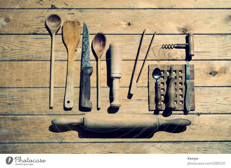The Housewife's Weapons Wooden spoon Old Retro Brown Nostalgia Rolling pin Knives Corkscrew Pan lifter Household item Wooden table Arrangement Subdued colour