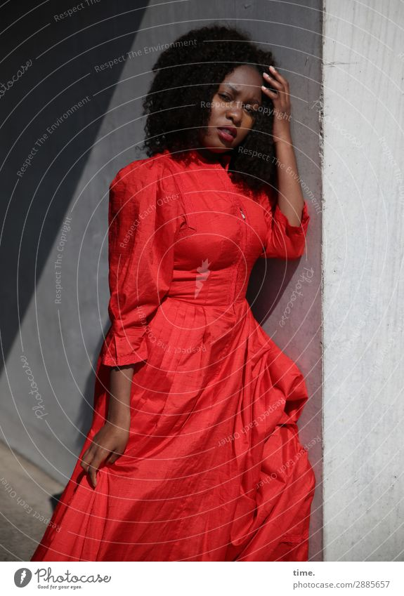 Woman Human being Red Adults Wall (building) Lanes & trails Feminine Wall (barrier) Hair and hairstyles Bright Elegant Stand Beautiful weather Observe Curiosity