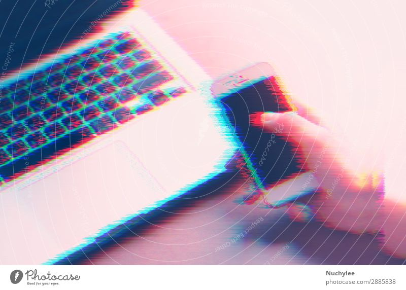 Hand using smartphone and laptop with glitch effect Business Work and employment Office Design Modern Technology Creativity Computer Telephone Profession