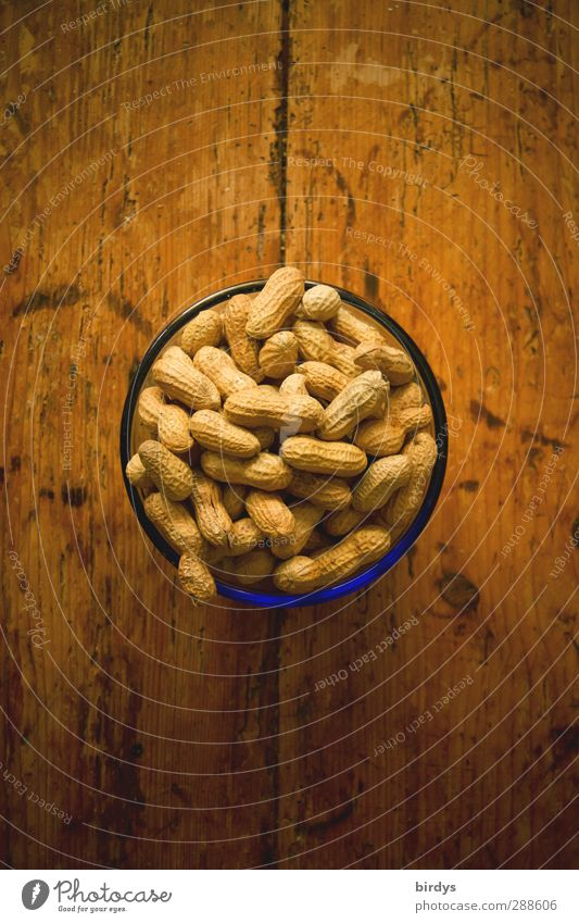 peanuts Peanut Bowl Table Wooden table To enjoy Delicious Round Snack Nibbles Nut Food photograph Colour photo Interior shot Deserted Copy Space top