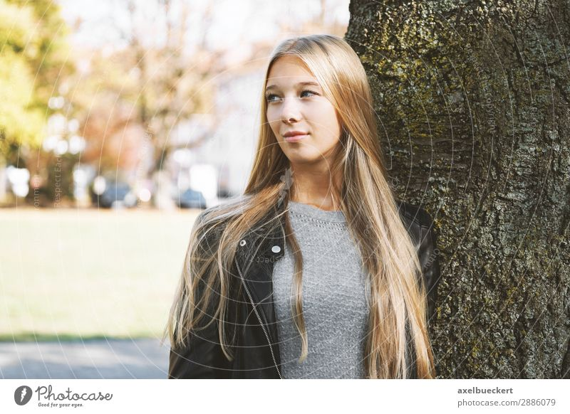dreamy young woman leaning against a tree Lifestyle Leisure and hobbies Human being Feminine Young woman Youth (Young adults) Woman Adults 1 13 - 18 years