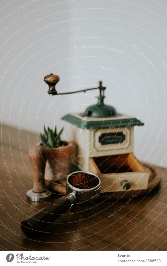 Old coffee grinder and portafilter on wooden table To have a coffee Hot drink Coffee Espresso Lifestyle Elegant Style Design Berlin Germany Esthetic Authentic