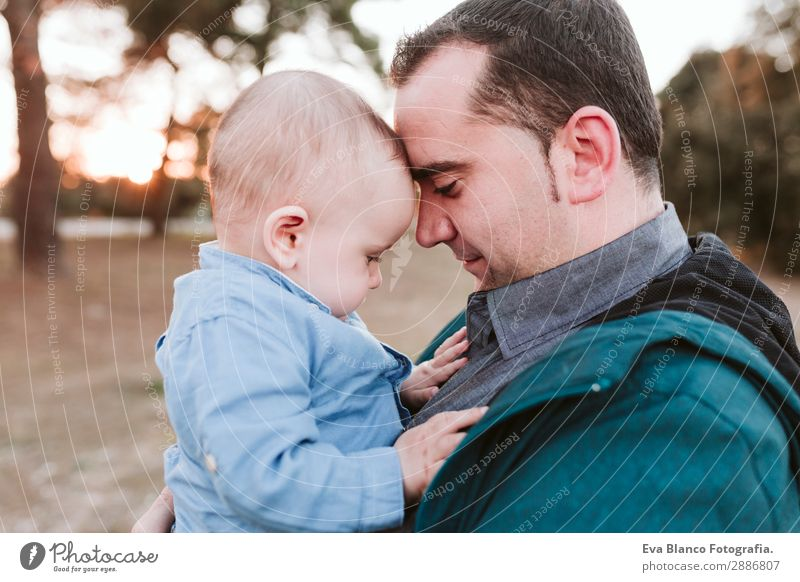 young dad and son playing outdoors at sunset. family concept Lifestyle Joy Beautiful Freedom Success Child Human being Masculine Baby Boy (child) Young man