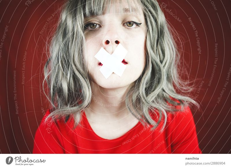Young woman with a cross covering her mouth Style Design Beautiful Hair and hairstyles Face Calm Human being Feminine Youth (Young adults) Woman Adults Mouth 1