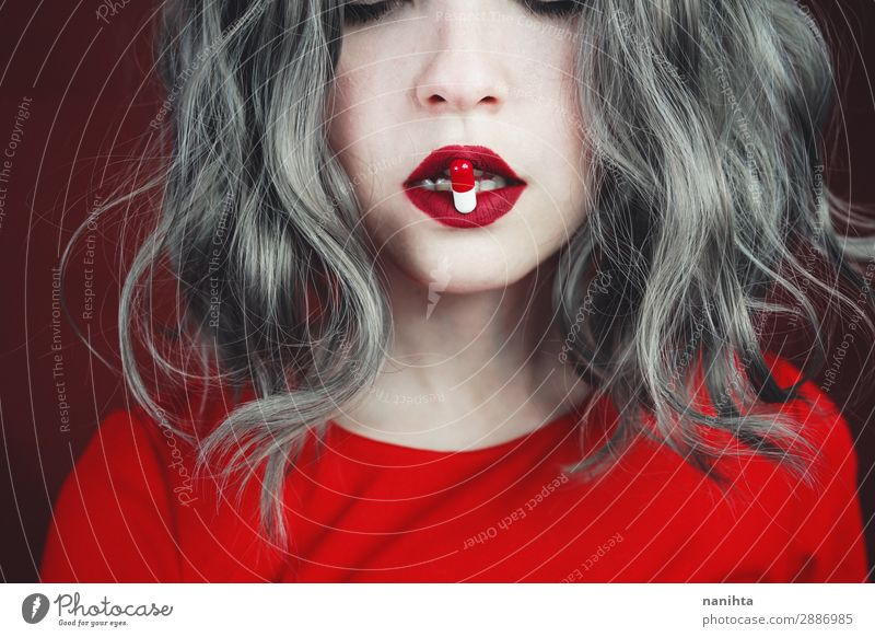 Close up of young woman's lips holding a pill Style Design Hair and hairstyles Skin Face Lipstick Health care Medical treatment Intoxicant Medication