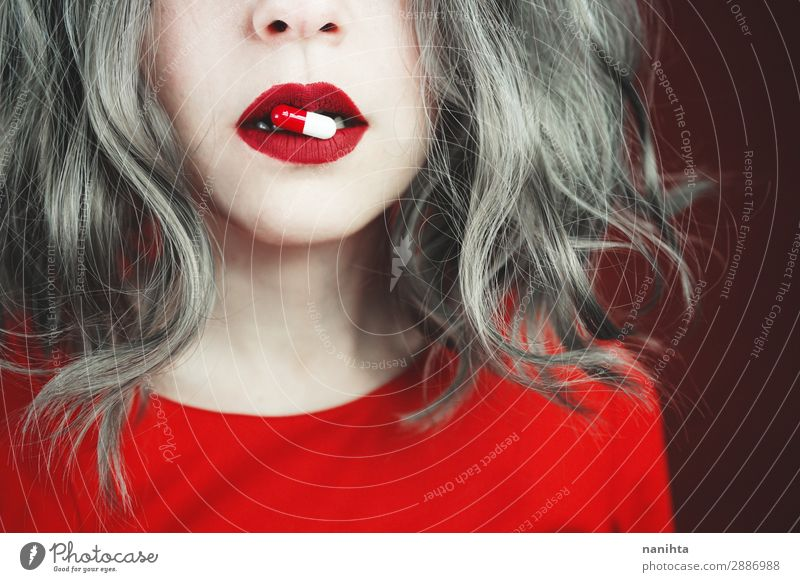 Close up of young woman's lips holding a pill Style Design Skin Face Lipstick Health care Medical treatment Intoxicant Medication Human being Feminine