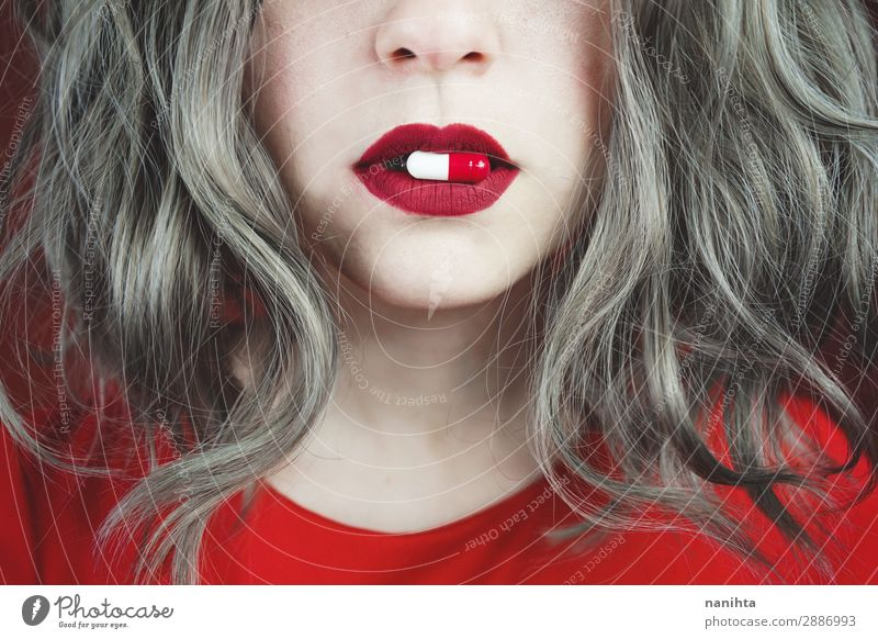 Close up of young woman's lips with a pill Woman Human being Youth (Young adults) Young woman Red 18 - 30 years Face Adults Feminine Health care Style Design