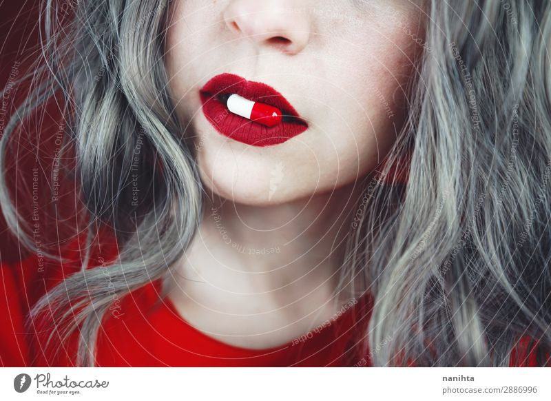 Close up of young woman's lips holding a pill Design Skin Face Lipstick Healthy Health care Medical treatment Intoxicant Medication Human being Feminine