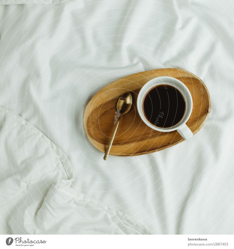 Cup of coffee and spoon on wooden tray in bed on white sheets Background picture Bedroom Beverage Black Breakfast Coffee Drinking Espresso Healthy Eating