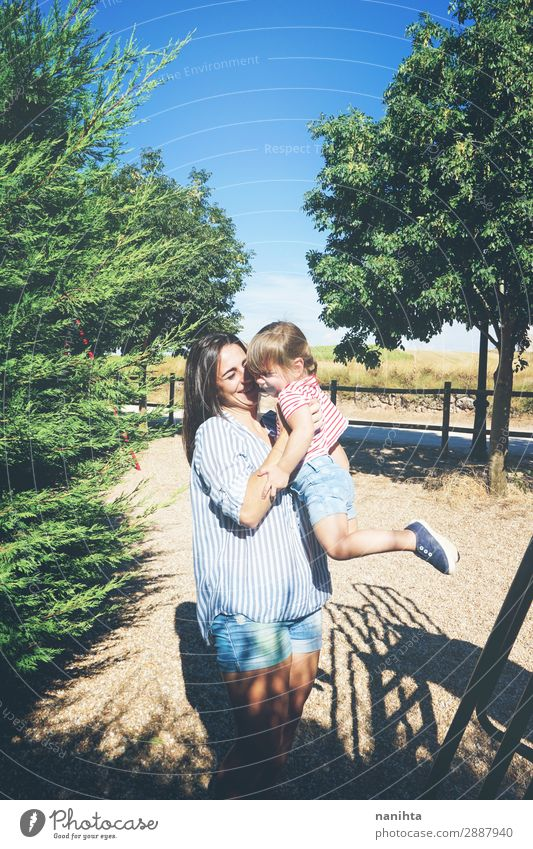 Mom and daughter having fun together in a park Lifestyle Joy Playing Summer Parenting Child Human being Feminine Toddler Girl Woman Adults Mother