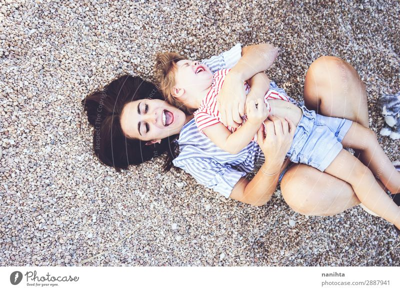 Mom and daughter having fun together in a park Lifestyle Joy Playing Summer Parenting Child Human being Feminine Toddler Woman Adults Mother Family & Relations