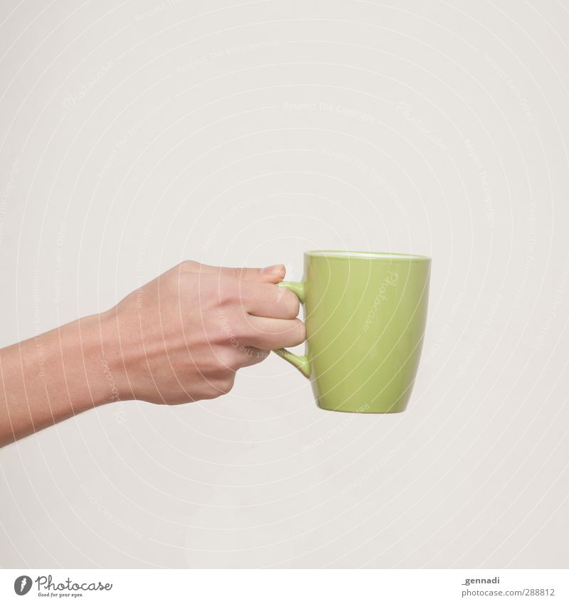 Here you go. Breakfast To have a coffee Beverage Drinking Hot drink Hot Chocolate Coffee Tea Arm Hand Warmth Green Square Calm Placed Neutral Give To hold on