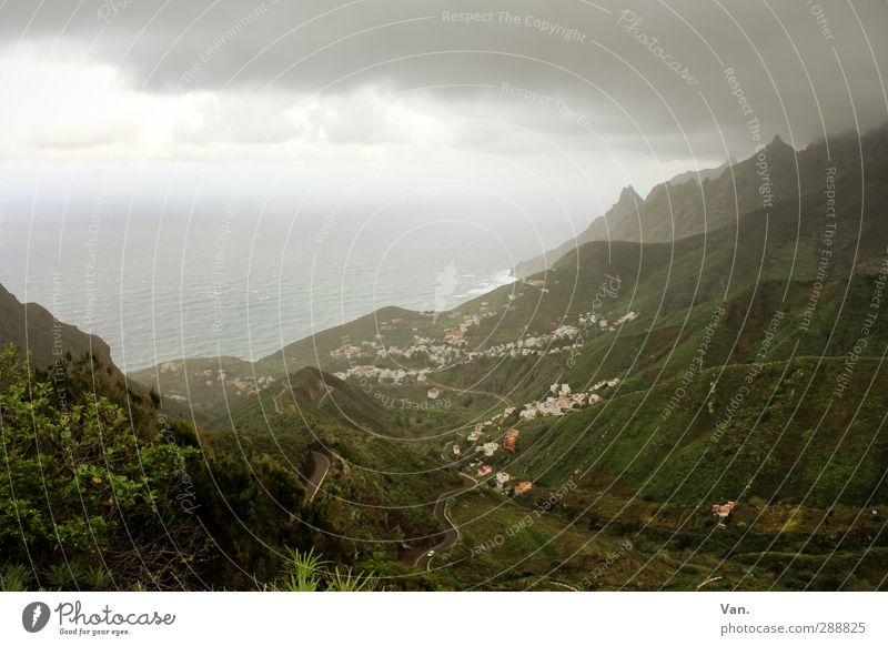 bad weather front Vacation & Travel Nature Landscape Sky Clouds Horizon Bad weather Grass Bushes Hill Mountain Coast Ocean Atlantic Ocean Tenerife Village Cold