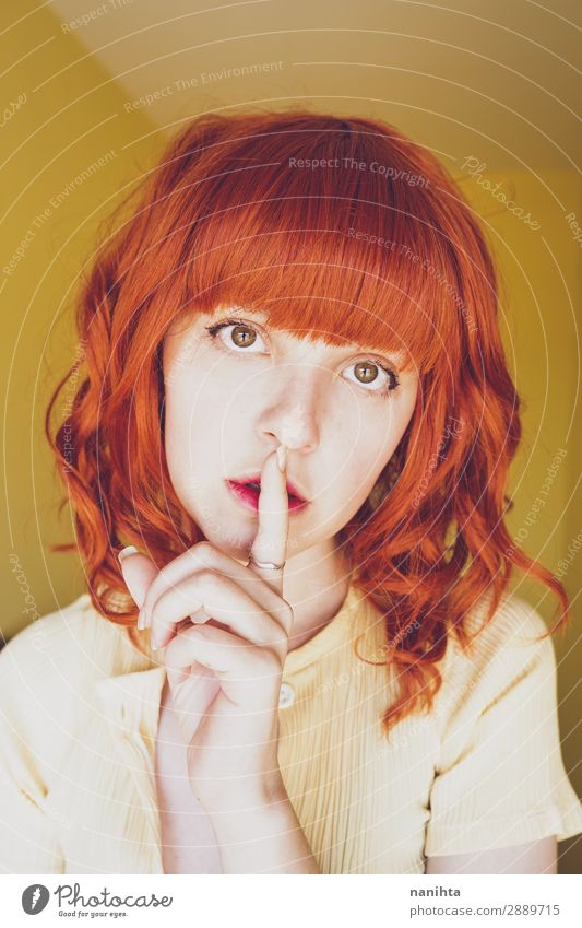 Young redhead woman doing a silent gesture Woman Human being Youth (Young adults) Young woman Beautiful White Calm 18 - 30 years Face Lifestyle Adults Yellow