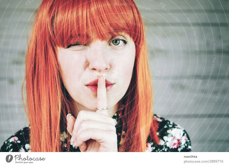 Young redhead woman doing a silent gesture Woman Human being Youth (Young adults) Young woman Beautiful White Calm 18 - 30 years Face Lifestyle Adults Feminine