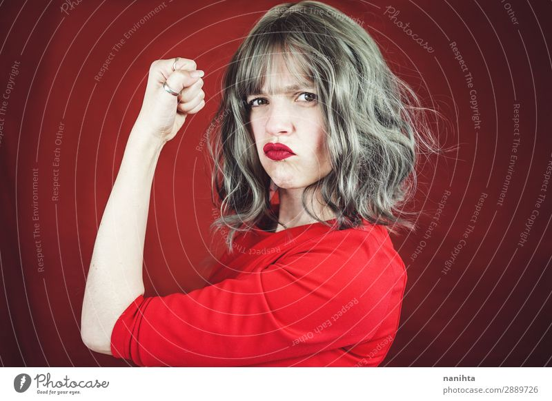 Young expressive woman in a classic feminist image Woman Human being Youth (Young adults) White Red Face Adults Funny Feminine Style Fashion Hair and hairstyles