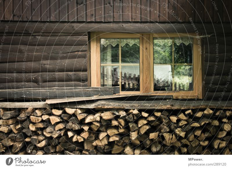 Tidy wood Village Wall (barrier) Wall (building) Facade Balcony Window Brown Wood Firewood Hut Chalet vacation Reflection Fuel Glass Farm Old Subdued colour