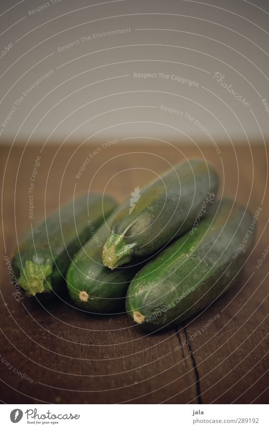 zucchini Food Vegetable Zucchini Organic produce Vegetarian diet Esthetic Fresh Healthy Delicious Brown Green Wooden table Colour photo Interior shot Deserted
