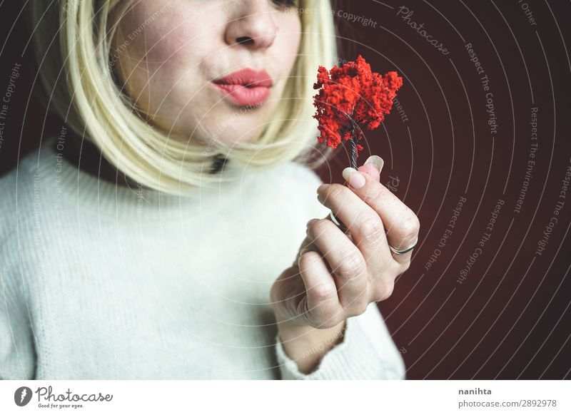 Young woman holding a little red tree Woman Human being Nature Red Tree Adults Autumn Environment Art Design Growth Authentic Perspective Future Uniqueness