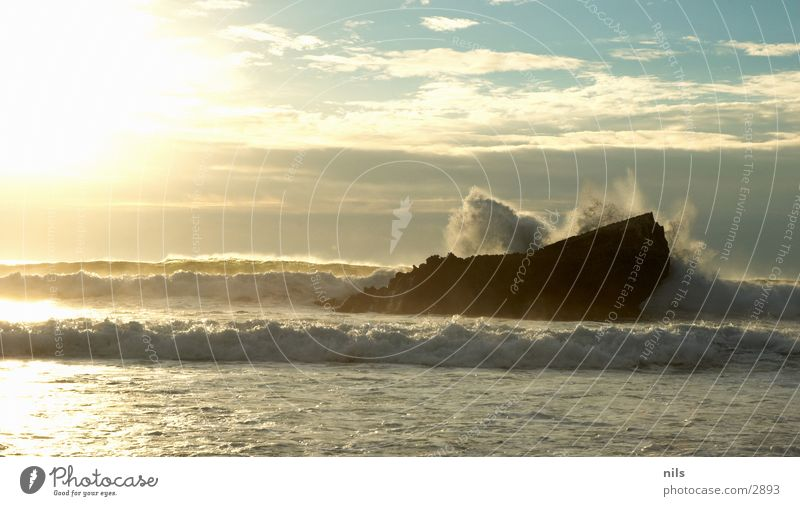 Water Sun Ocean Waves Rock To break (something) Surf Explosion Bursting White crest Evening sun