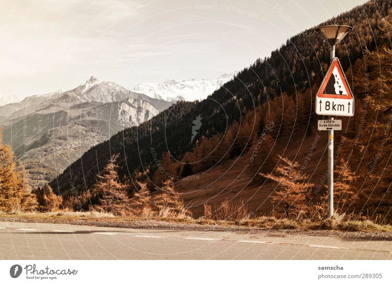 on the Forclaz Mountain Environment Nature Landscape Sky Climate Climate change Hill Rock Alps Peak Snowcapped peak Traffic infrastructure Street Road sign Sign