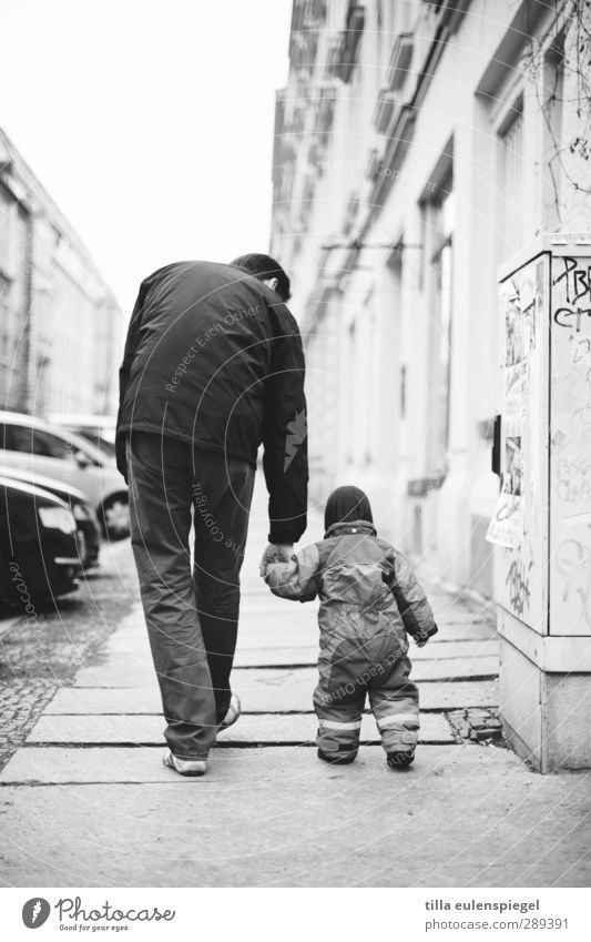 Human being Man House (Residential Structure) Adults Small Car Family & Relations Facade Large Walking Help To hold on Footpath Sidewalk Toddler Father