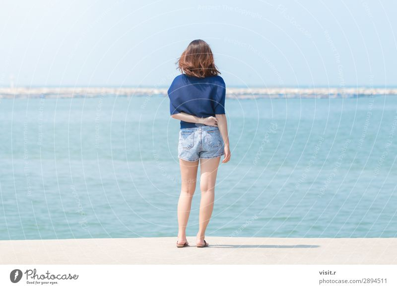 Asian woman standing on the terrace and looking around the sea. Woman Human being Sky Vacation & Travel Nature Summer Blue Beautiful White Landscape Ocean