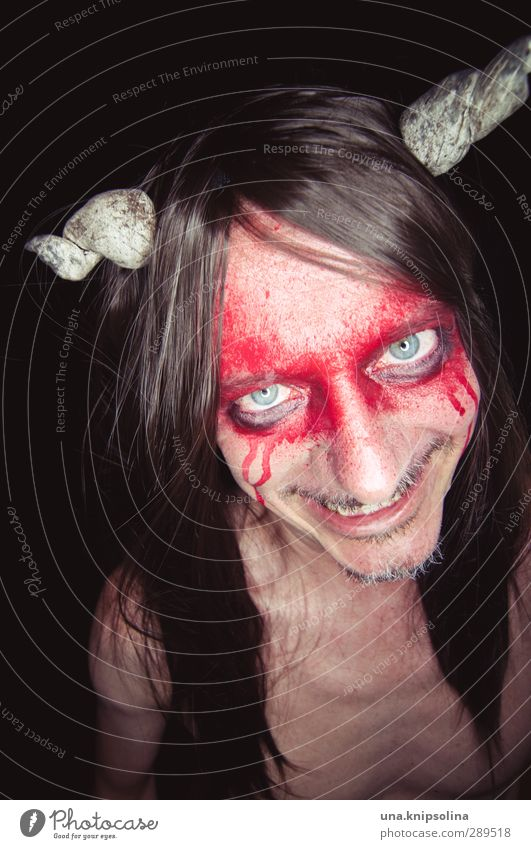 You're going to burn in hell! Make-up Man Adults 1 Human being 30 - 45 years Brunette Long-haired Observe Smiling Laughter Aggression Exceptional Threat Dark