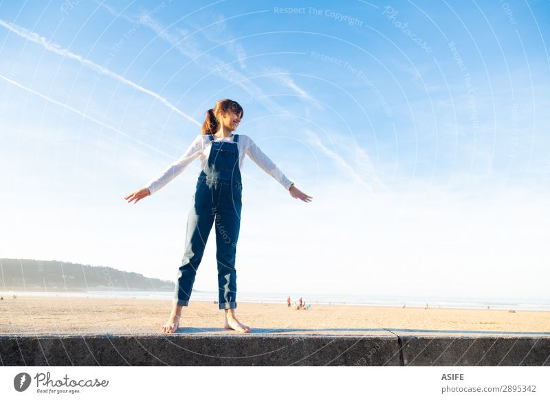 Little girl feeling free on the beach Joy Happy Beautiful Playing Vacation & Travel Freedom Summer Beach Ocean Child Arm Nature Sand Sky Coast Jeans Brunette
