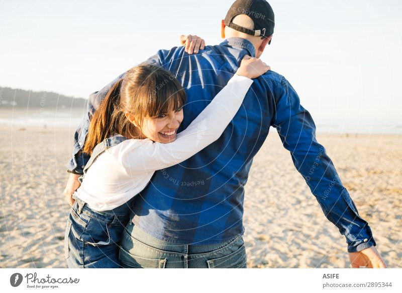 Father and daughter playing piggyback on the beach Joy Happy Beautiful Playing Beach Child Adults Family & Relations Jeans Bald or shaved head Smiling Love