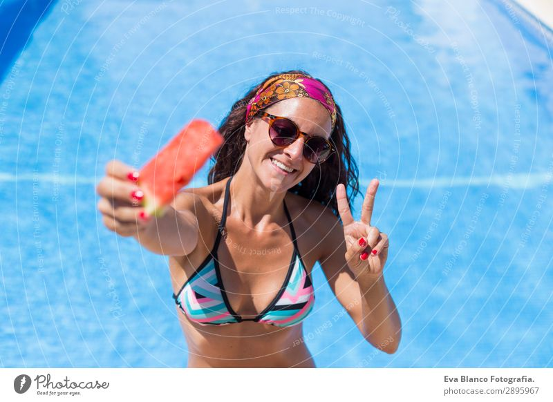 beautiful young woman holding a piece of watermelon Woman Human being Vacation & Travel Youth (Young adults) Young woman Summer Blue Beautiful Red Hand Sun Joy