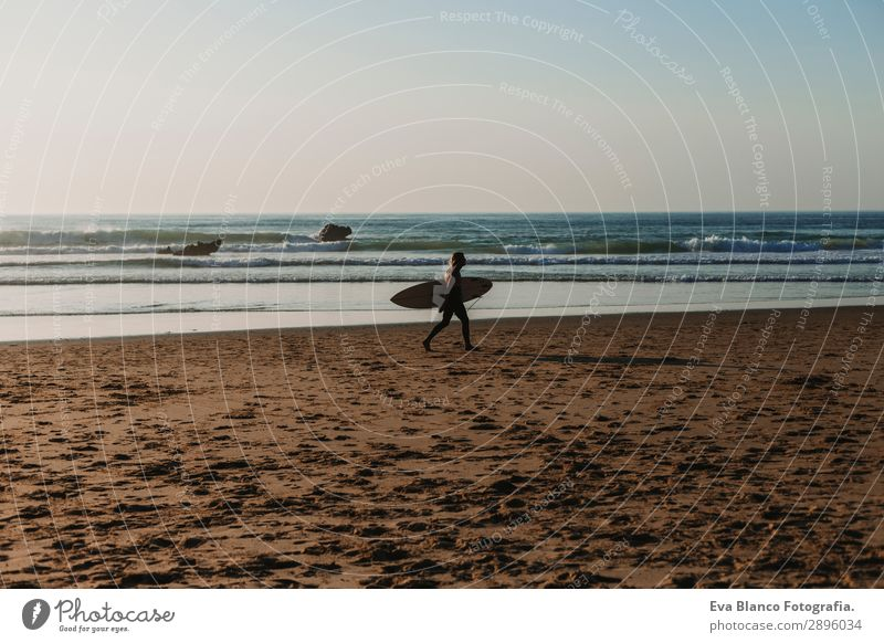 young surfer man walking by the sea shore Lifestyle Joy Relaxation Leisure and hobbies Vacation & Travel Tourism Adventure Freedom Summer Beach Ocean Sports