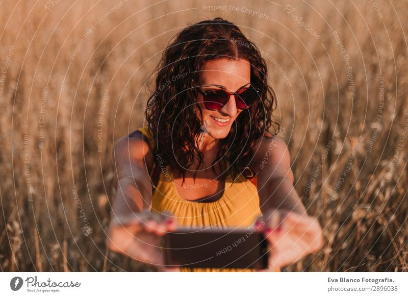 Young beautiful woman in yellow dress taking a selfie Woman Human being Vacation & Travel Nature Youth (Young adults) Young woman Summer Beautiful Landscape Sun