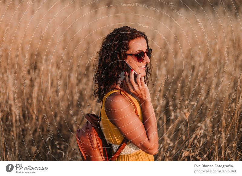 Young beautiful woman in yellow dress talking with mobile phone Woman Human being Vacation & Travel Nature Youth (Young adults) Young woman Summer Beautiful