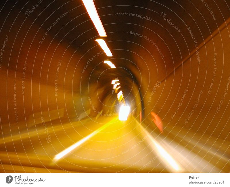 Speed in the tunnel Tunnel Light Long exposure Yellow Tunnel vision Reaction Orange