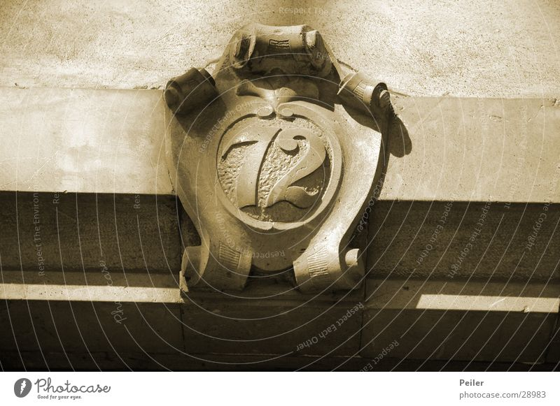 72, what else? Digits and numbers Coat of arms House number Craft (trade) Sepia Black & white photo