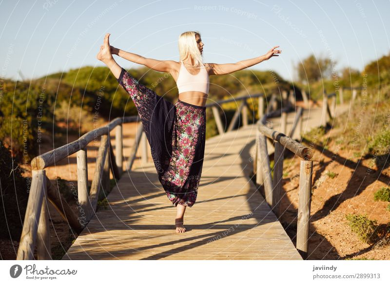 Caucasian female practicing yoga on wooden bridge. Woman Human being Sky Nature Youth (Young adults) Young woman Summer Beautiful Sun Relaxation Calm Joy Beach