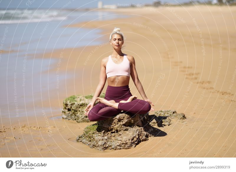 Caucasian blonde woman practicing yoga in the beach Lifestyle Beautiful Body Harmonious Relaxation Calm Meditation Summer Beach Ocean Sports Yoga Human being