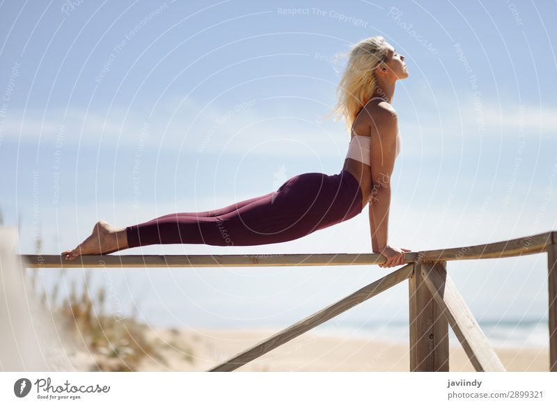 Caucasian blonde woman practicing yoga in the beach Woman Human being Sky Nature Youth (Young adults) Young woman Summer Beautiful Ocean Relaxation Calm Joy