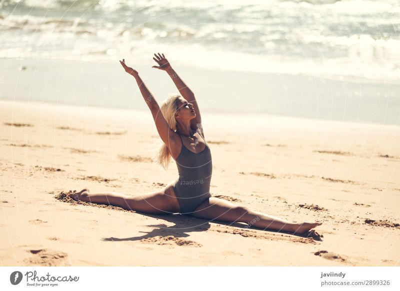 Caucasian blonde woman practicing yoga in the beach Woman Human being Sky Nature Youth (Young adults) Young woman Summer Beautiful Ocean Relaxation Calm Beach