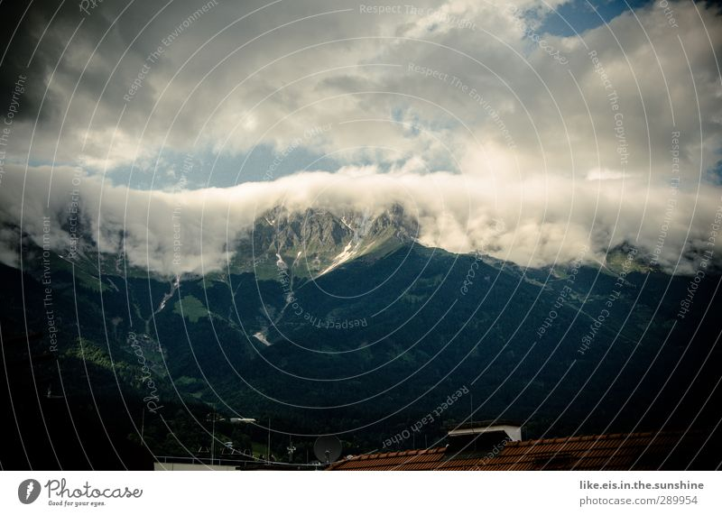 cloud waterfalls over innsbruck Far-off places Snow Mountain Environment Nature Landscape Elements Clouds Climate Weather Alps Peak Town Roof Chimney Large