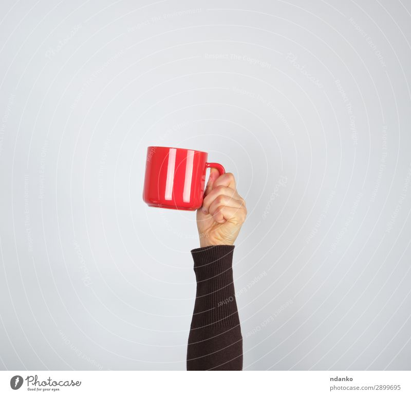 red ceramic cup in a female hand on a white background Breakfast Beverage Coffee Espresso Tea Cup Mug Woman Adults Hand 1 Human being 18 - 30 years
