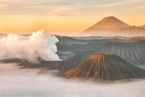Mount Bromo volcano at sunrise, East Java, Indonesia. Vacation & Travel Tourism Adventure Freedom Mountain Hiking Environment Nature Landscape Earth Sky Clouds