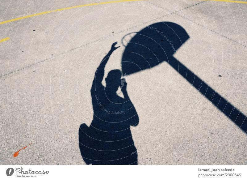 man shadow silhouette playing basket Silhouette Human being Man Playing Basket Sports Shadow Light (Natural Phenomenon) Sun Street Ground Exterior shot City